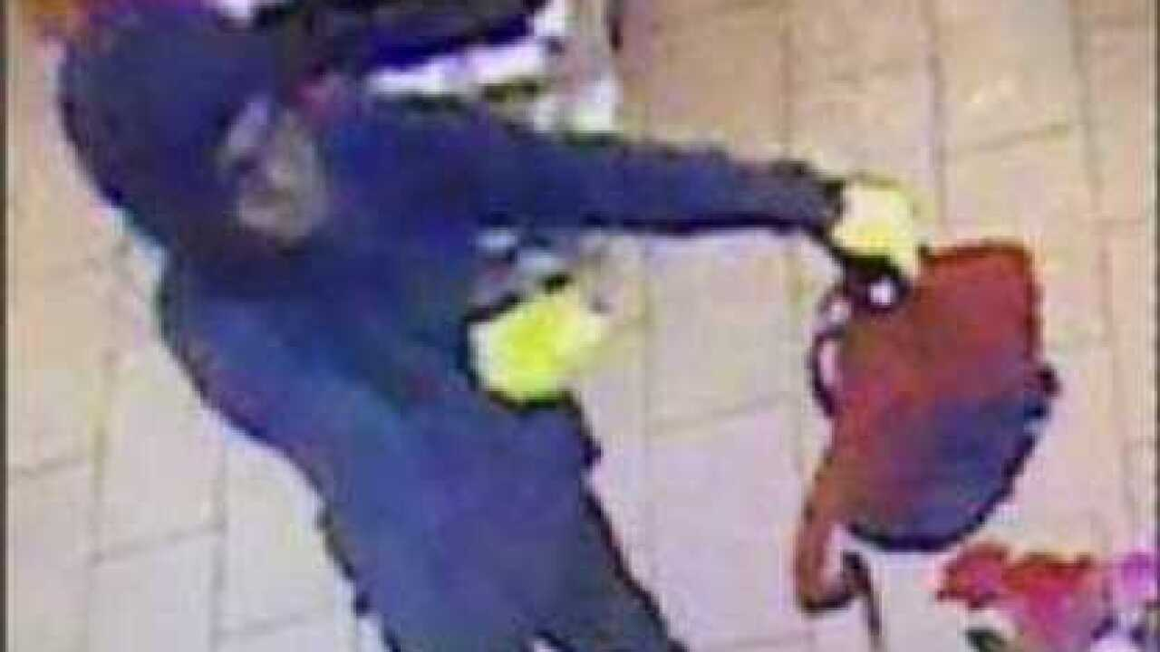 Investigators search for man wanted in robbery