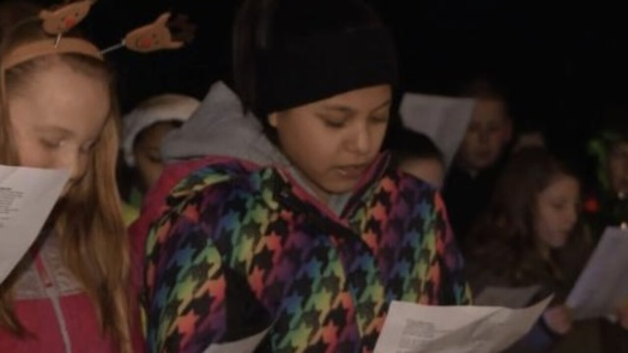 Carolers surprise young cancer patient in DeWitt
