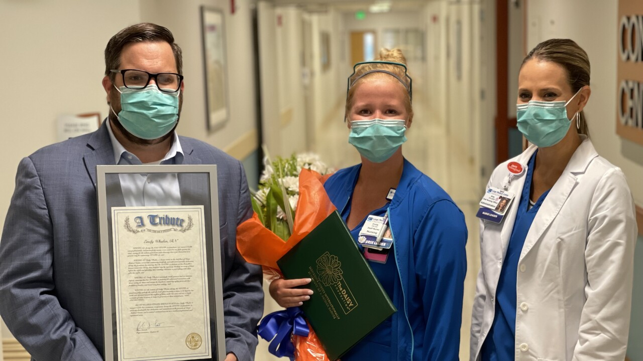 Rep. Chris Latvala awards Emily Whalen RN.jpg