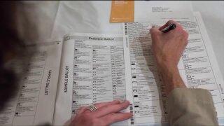 Woman filling out a ballot