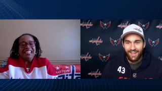 Capitals player Tom Wilson surprises Vicki White, a nurse at Harbor Hospital in Baltimore
