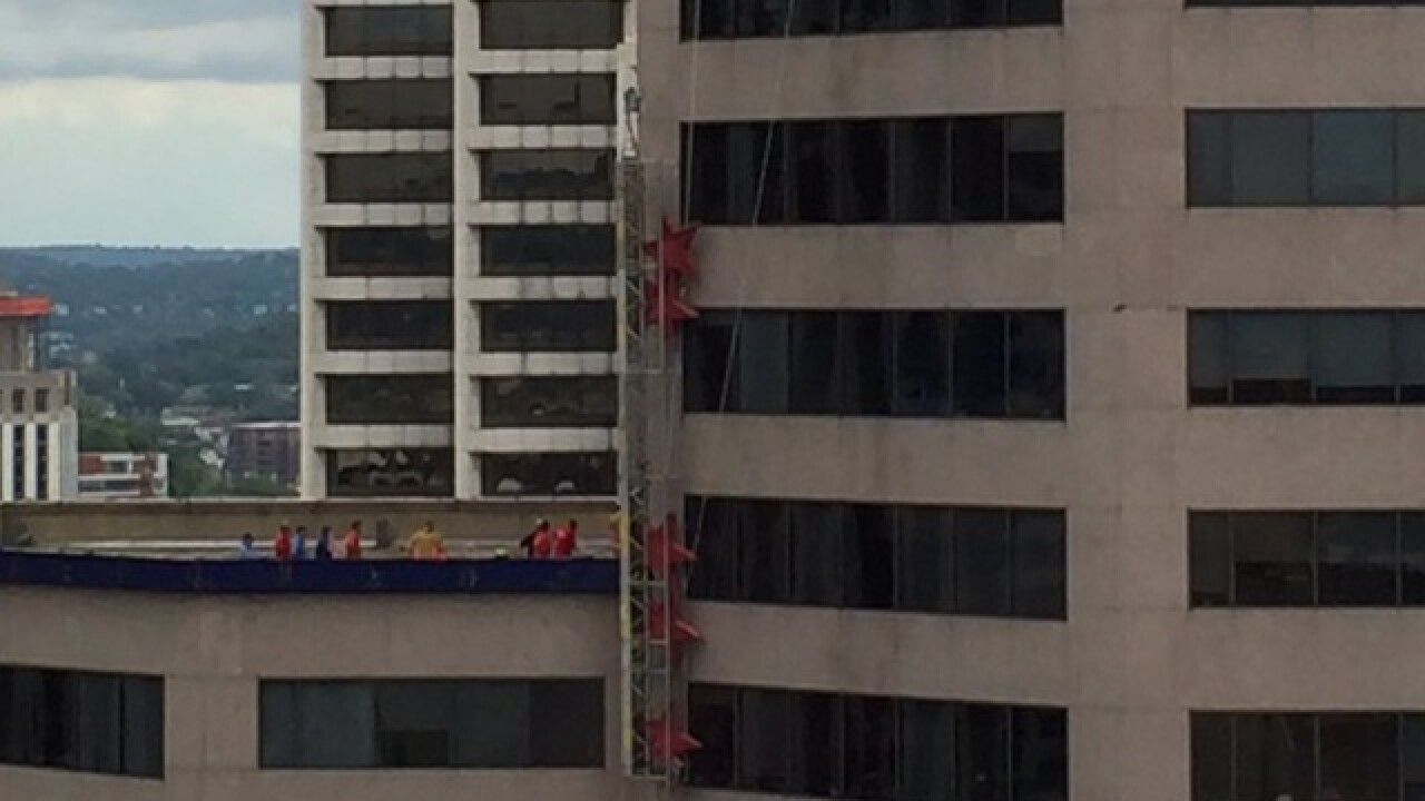 Window-washing platform dangles off high-rise