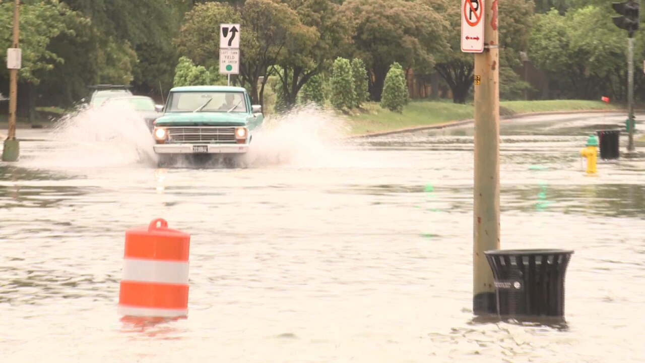A truck drives through a flooded intersection in Norfolk, Virginia