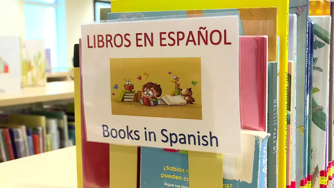 'Libros En Espanol, Books in Spanish' sign at Paula A. Lewis Branch Library