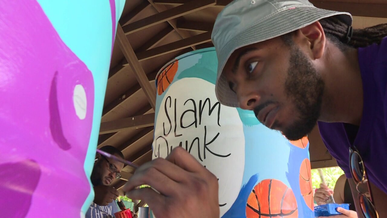 Artists spruce up trash cans at Lafayette Park at 1st Annual 'Paint the Park' event