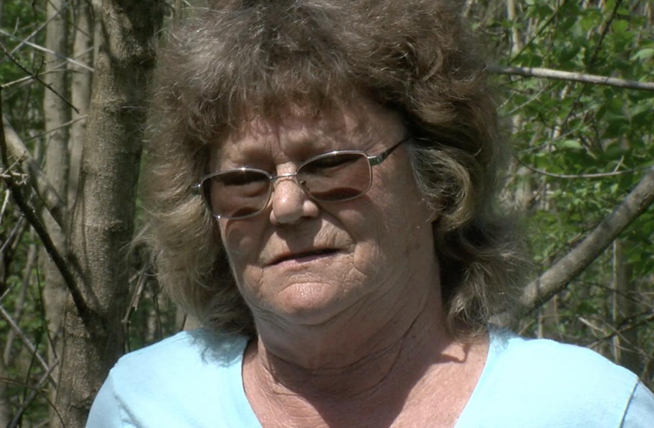 Judy Hurst standing on floodplain land where her childhood house once stood near Beckjord.