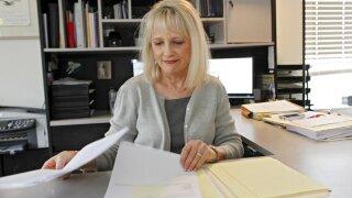Woman Working Behind Desk