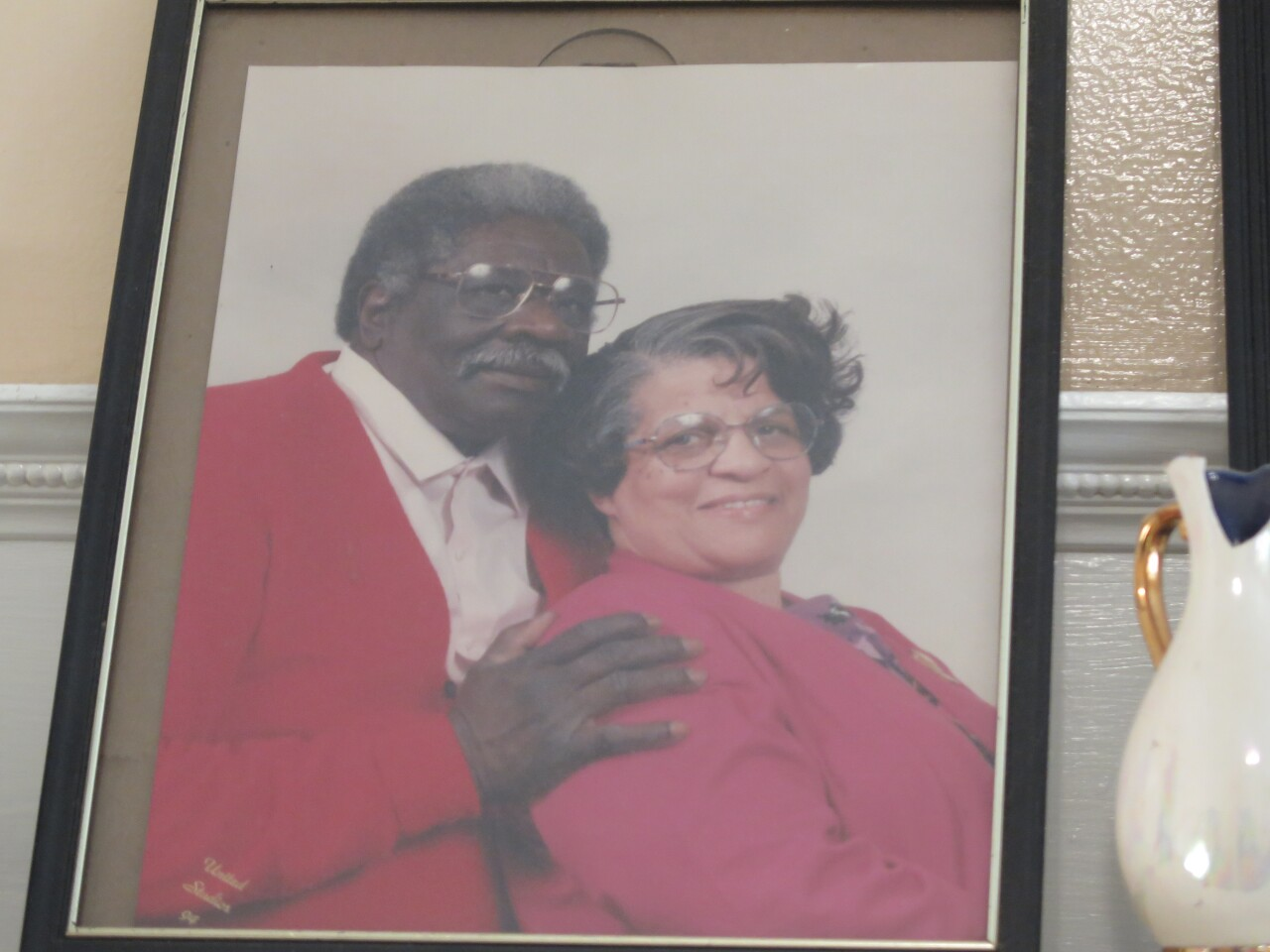 This picture shows a portrait of Robert McCrary and his late wife, Verline He has his hand on her shoulder, and they both are smiling.
