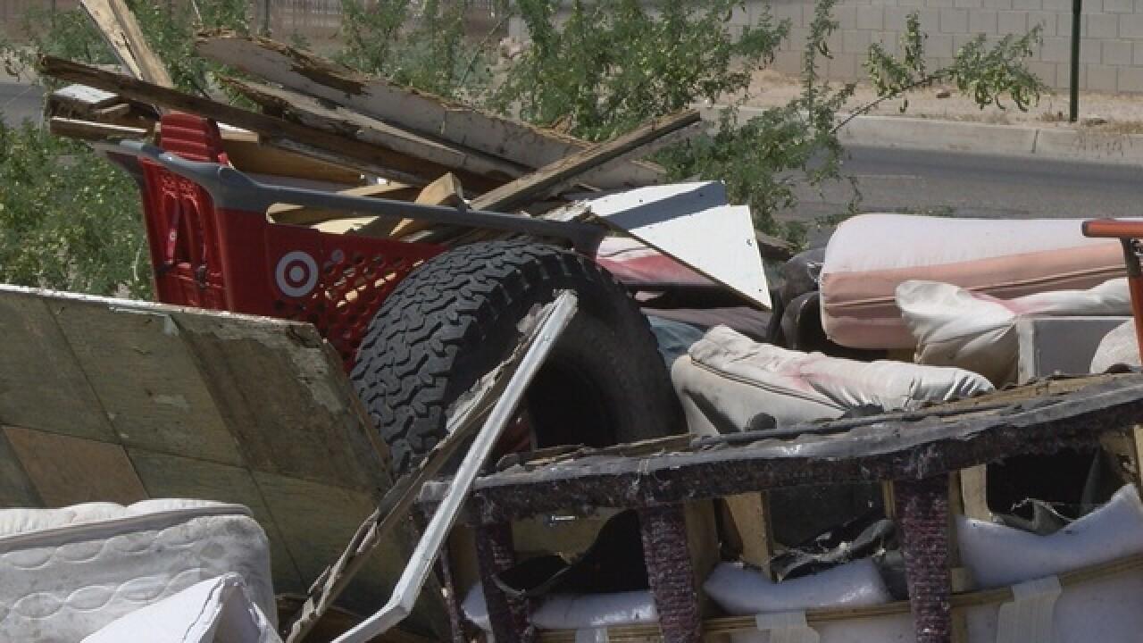 Neighborhood fed up with growing trash site
