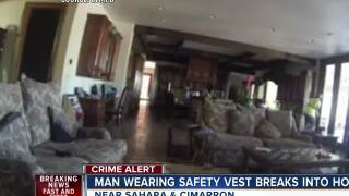 Man in safety vest seen in home