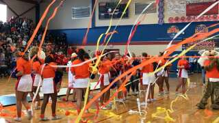 Red and blue Wildcats go orange to support fight against kid cancer