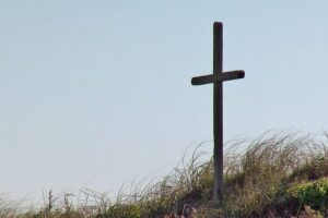 Witnesses report body washed ashore near large cross