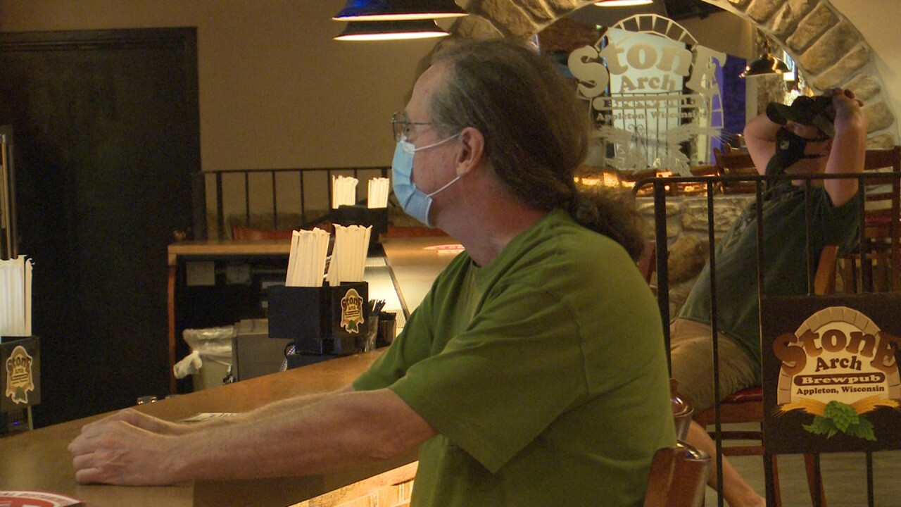 Indoor bar patrons at Stone Arch Brewpub in Appleton wear masks as required by Governor Evers' statewide mandate.