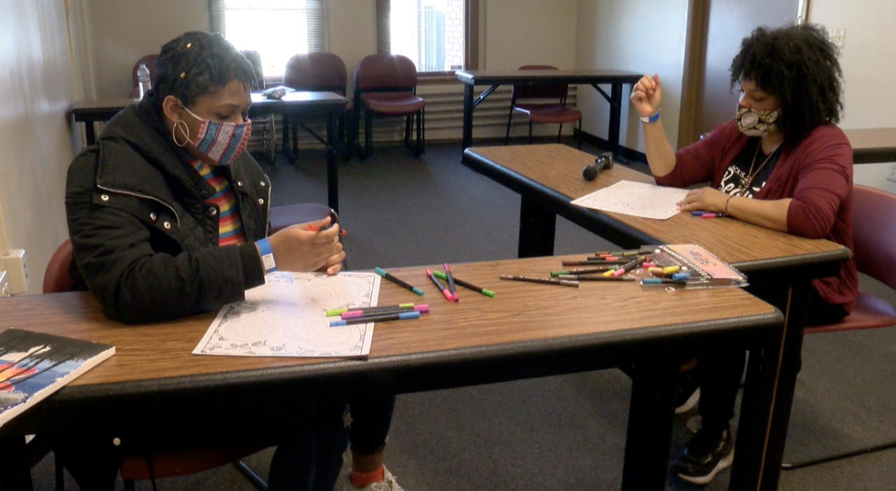 Golden Brown (mentee)  and Whitney Bingham (mentor) work on art at Running Rebels