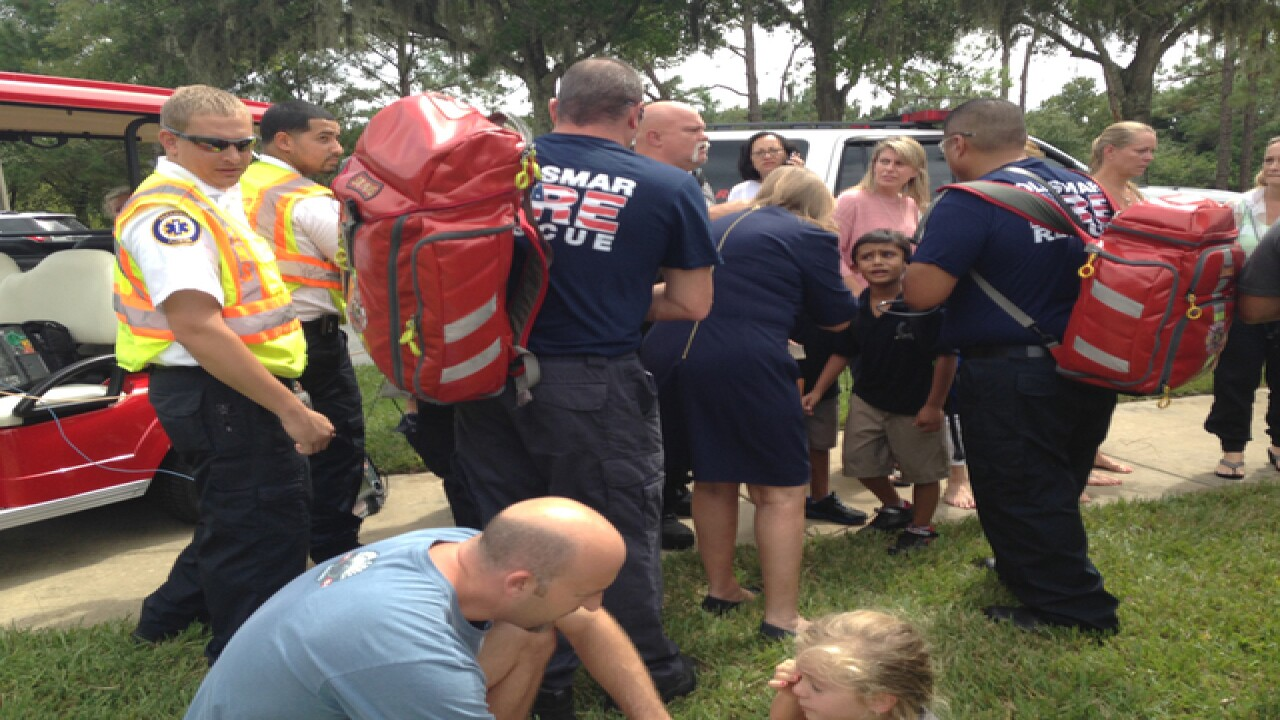Father, son rushed to pull kids from bus in pond