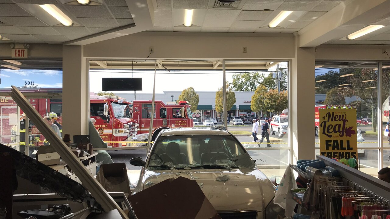 Vehicle crashes into Suffolk storefront