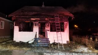 Man and dog escape house fire in Butte