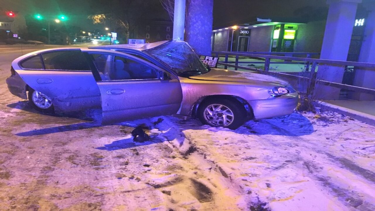 Two people ok after car hits pole near midtown