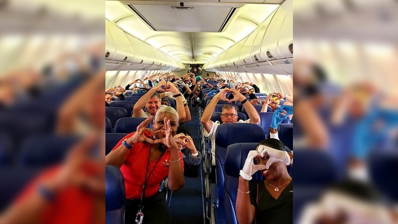 Photo of health care workers flying to help fight COVID-19 in New York goes viral