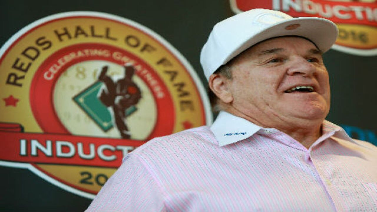 Banned from baseball, Reds retire Pete Rose's number