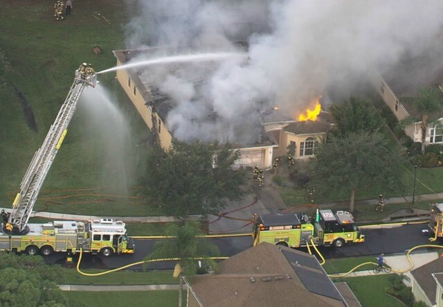 PHOTOS: House fire destroys home North River Road