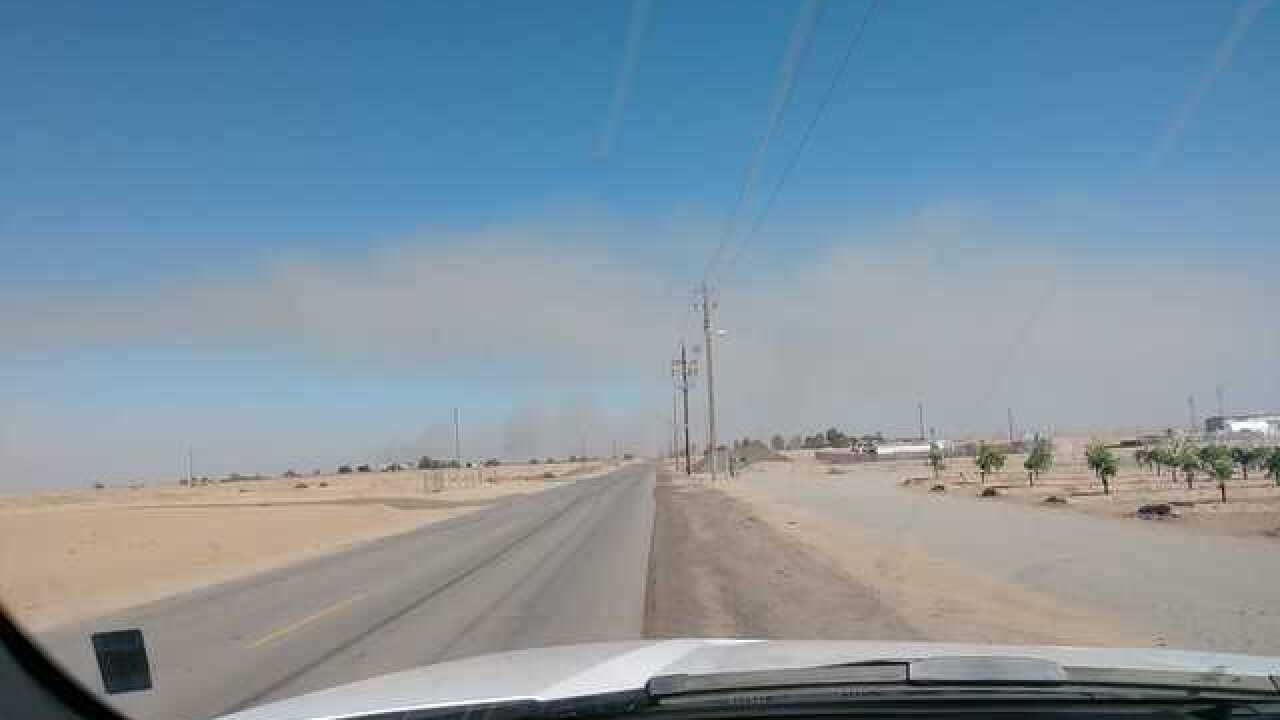 Grass fire burning east of HWY 65