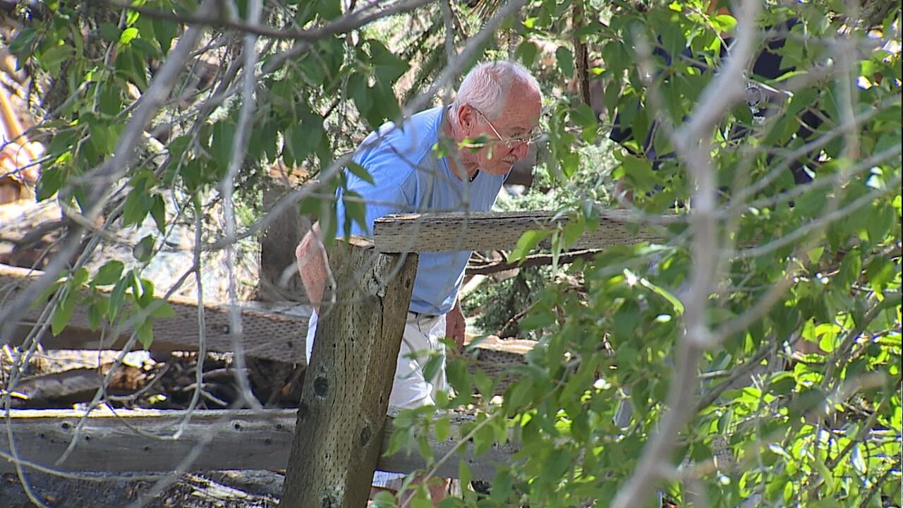Jerry Wilkerson looking through debris