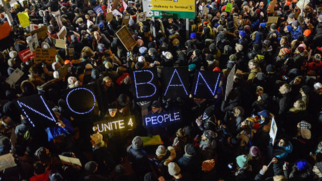 Federal court temporarily halts Donald Trump's immigration ban