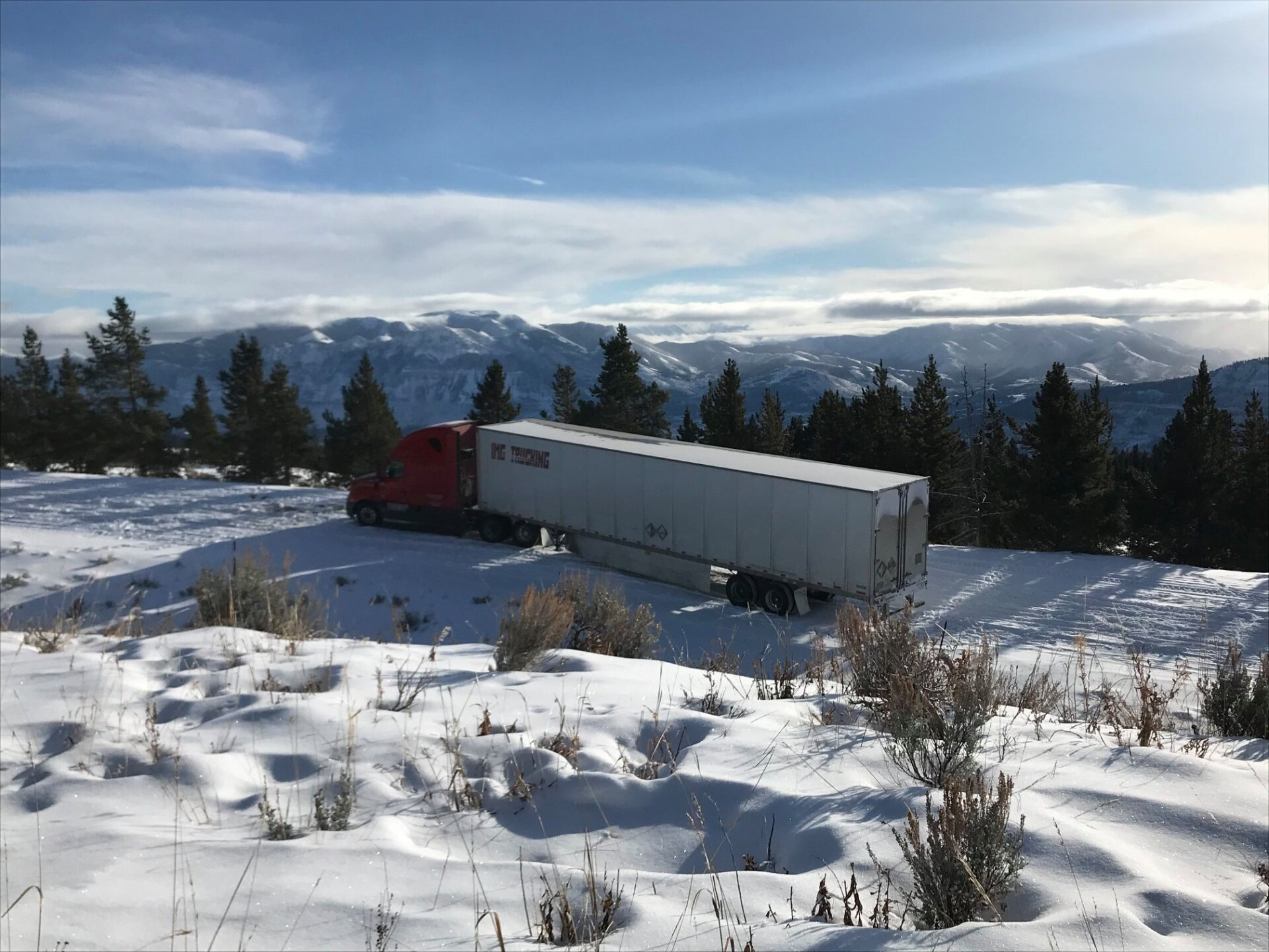 Photos: Authorities urge winter preparedness after semi (hauling snowmobiles) gets stuck inWyoming