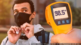 picture of a man with a face mask and a temperature gauge