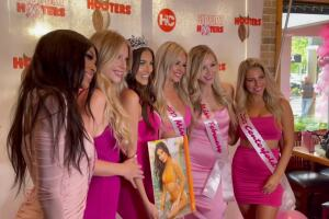 Gianna Tulio surrounded by other Hooters calendars girls, Oct. 1, 2021