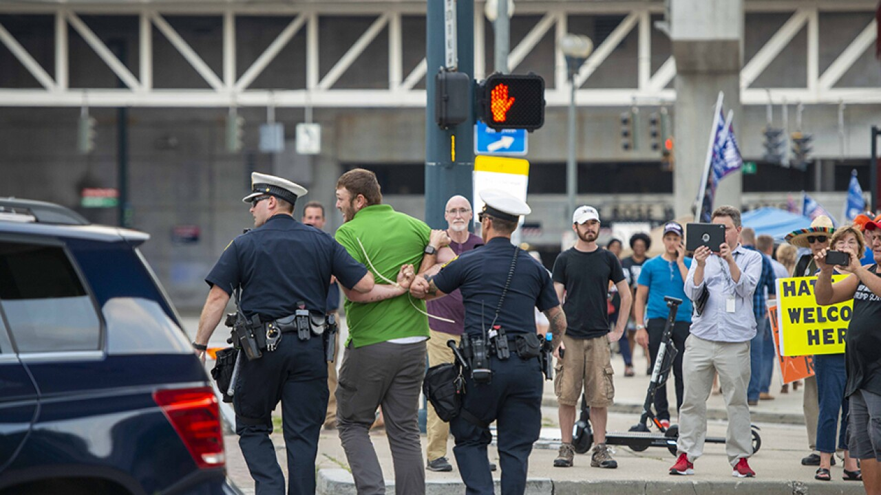 Police: Man charged with assault after punching anti-Trump
