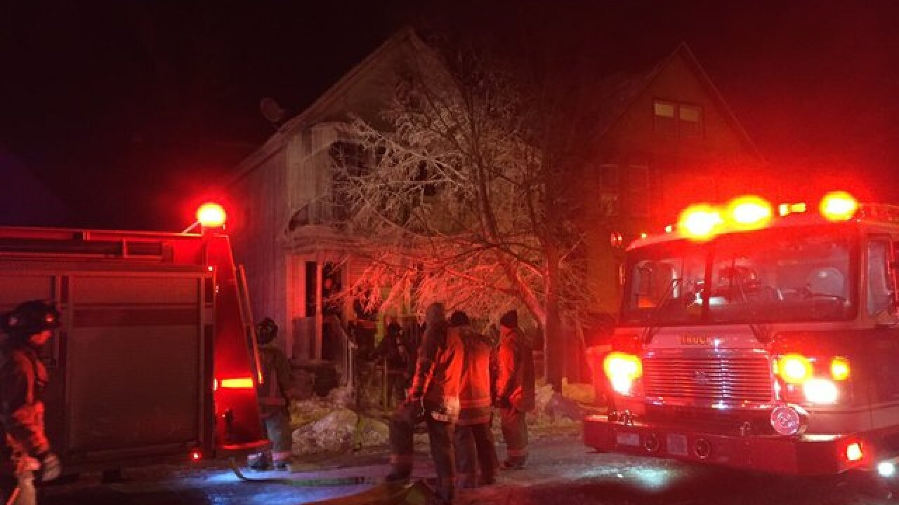 Fire sends two firefighters to hospital, forces two families out of West Side home
