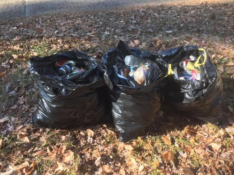 Photos: Community takes action to clean up trash near Colonial Parkway National Park amid government shutdown