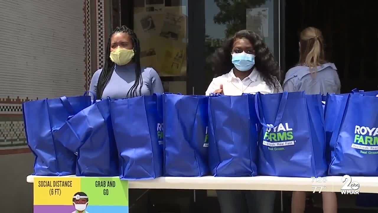 Grocery giveaway, Royal Farms and Living Classrooms feed 300 residents.jpg