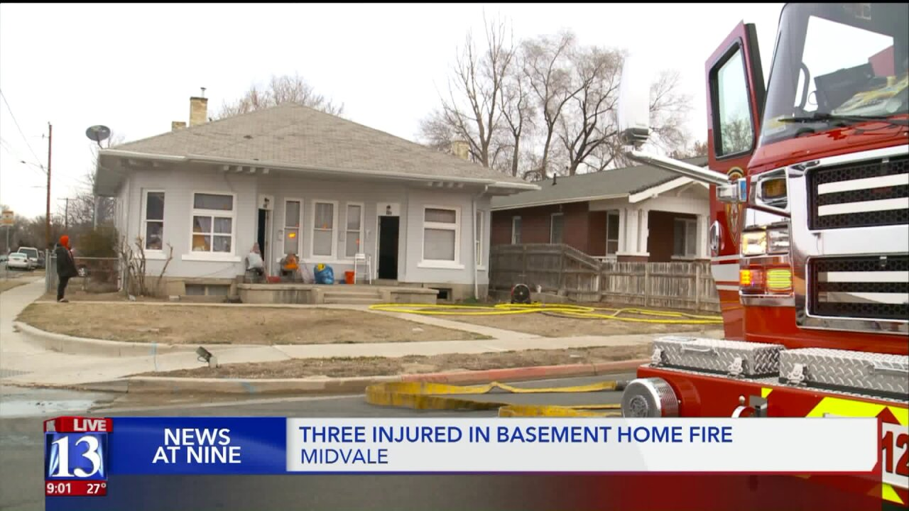 Woman pulled to safety from basement window during fire inMidvale