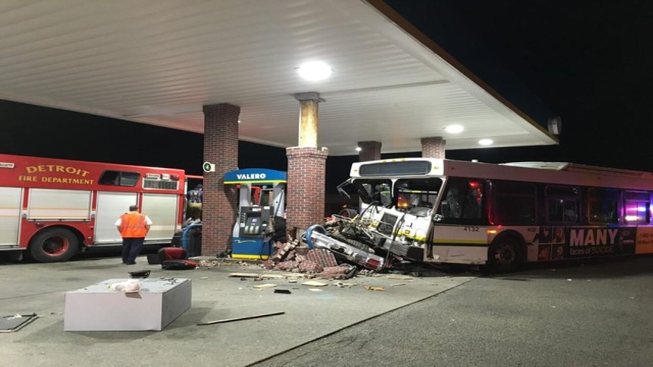 DDOT bus, vehicle crash into gas station pump