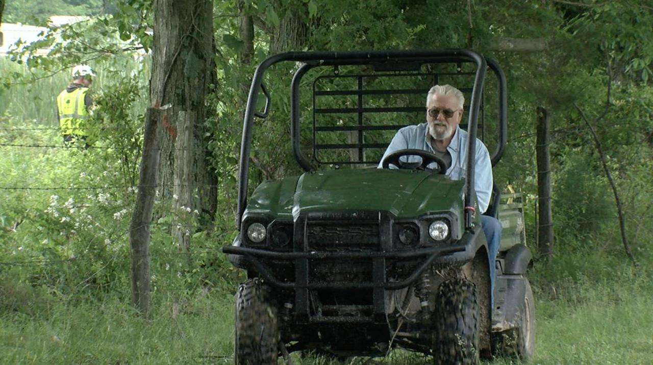 Tom Brown surveys his farm near Bethel.