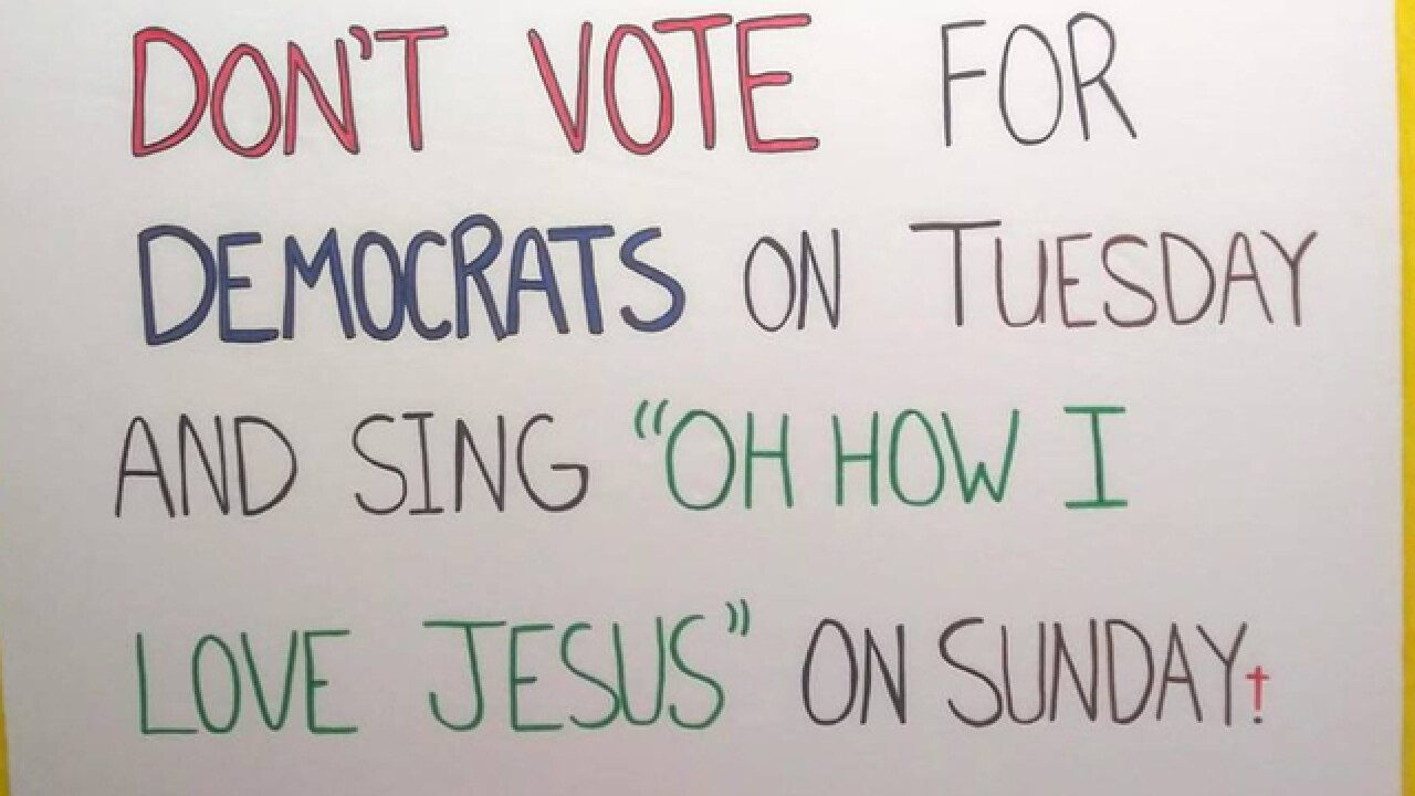 Sign outside Pasco polling location warns voters not to praise Jesus after voting for Democrats