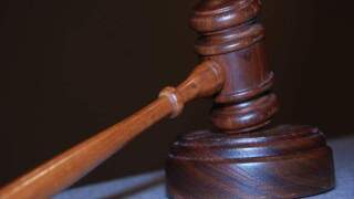 Convicted murderer's brother charged with lying under oath at trial