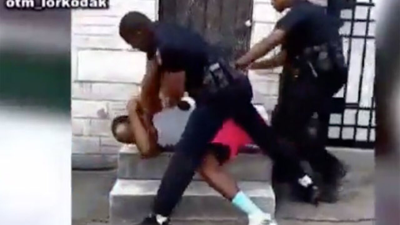 Baltimore police officer resigns after video shows him repeatedly punching man