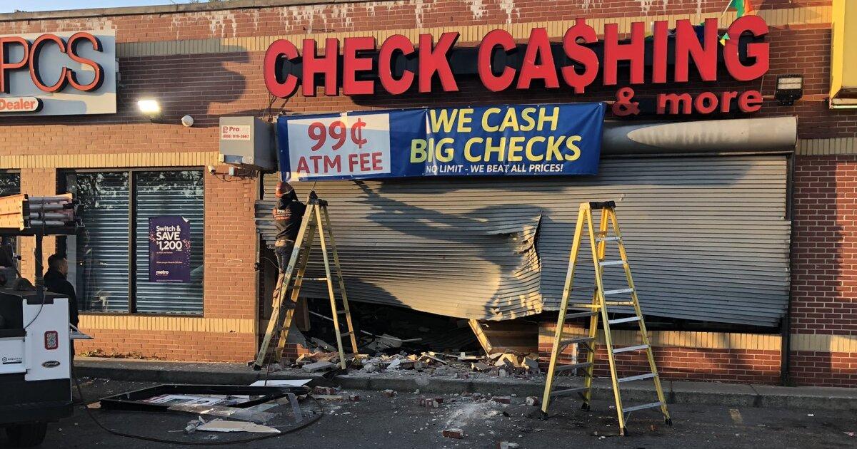 Pair carjacks tow truck at gunpoint, rams into check cashing business in Detroit