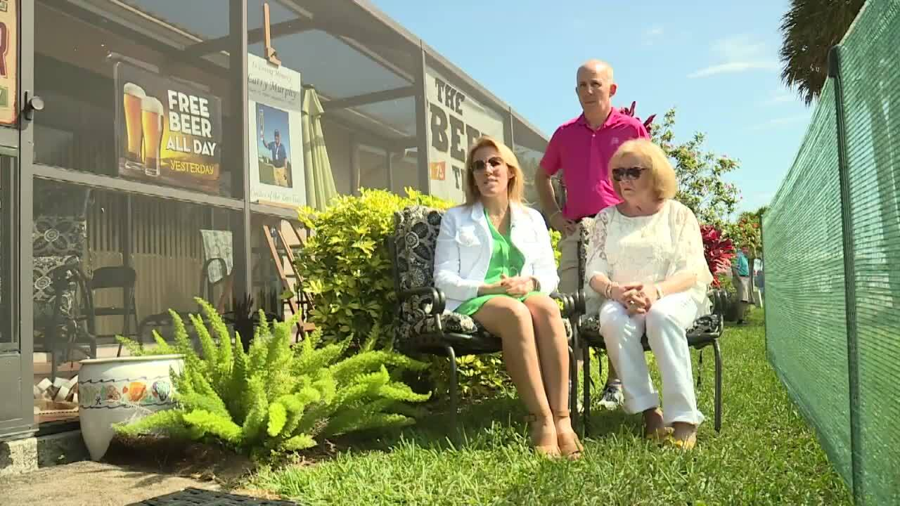 Amy Messick and family sit outside the 'Beer Trap'