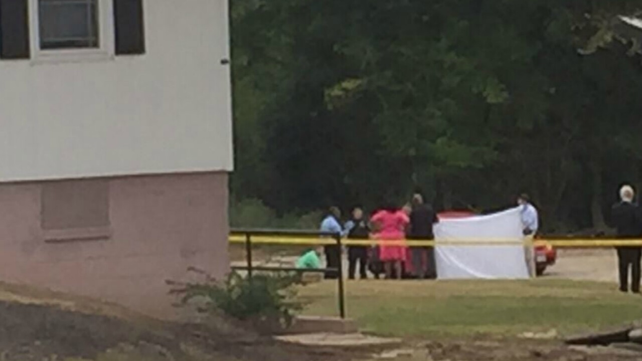 Maintenance worker finds two dead in red car outside Petersburg apartments