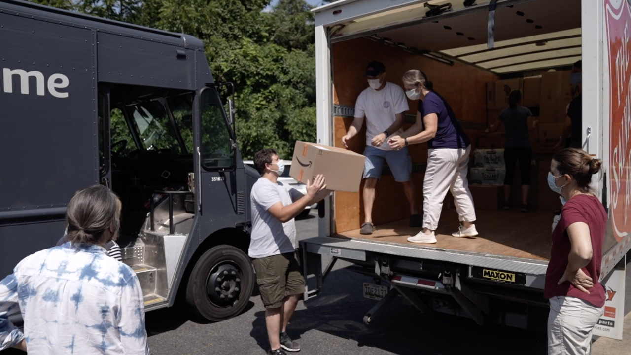 Volunteers handle boxes of donations arriving at Bethlehem Lutheran Church in Fairfax, Virginia. The boxes contain the basic necessities for a new life, which are destined for Afghan allies and their families now arriving in the U.S.