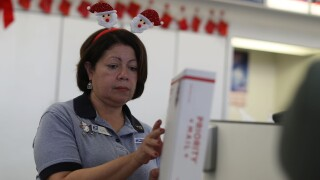 Postal Service Employees Work Through The Holiday Busy Period
