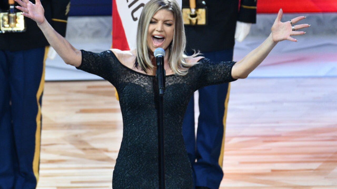 Fergie says she tried her best in statement on national anthem performance