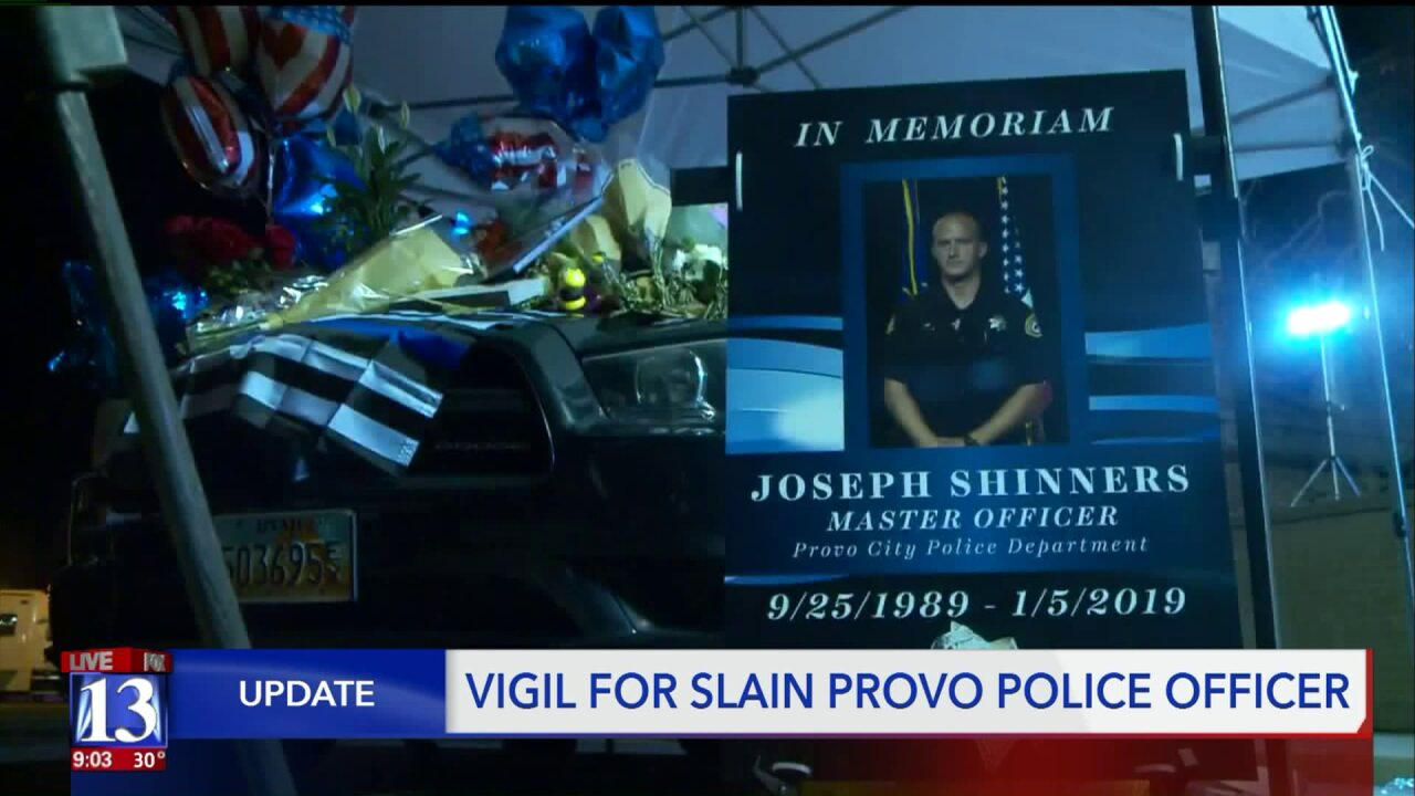 Family, friends share memories of Officer Joseph Shinners at candlelight vigil