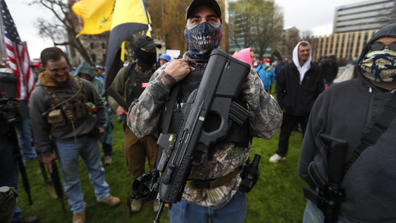 Michigan militia puts armed protest in the spotlight