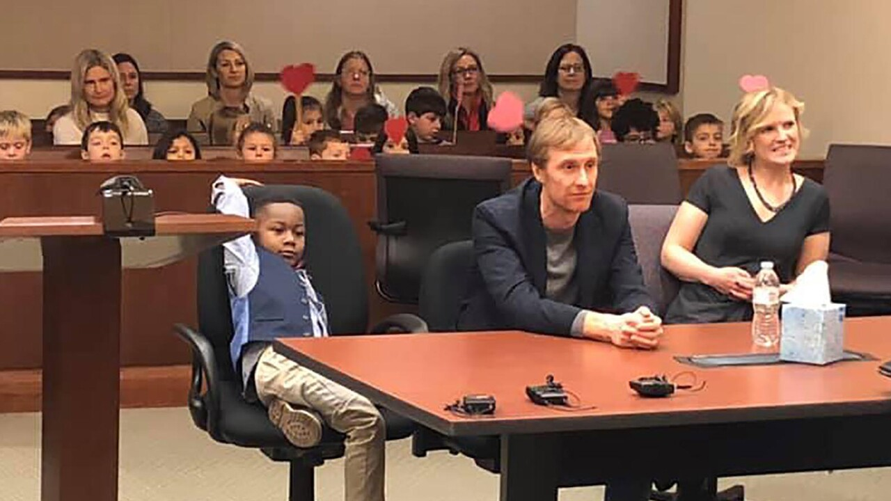 Five-year-old Michael's entire kindergarten class sat in the audience behind him waving big red hearts mounted on wooden sticks to show their support.